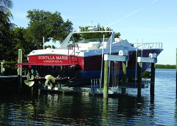 Boat is lifted out of the water by boat crane